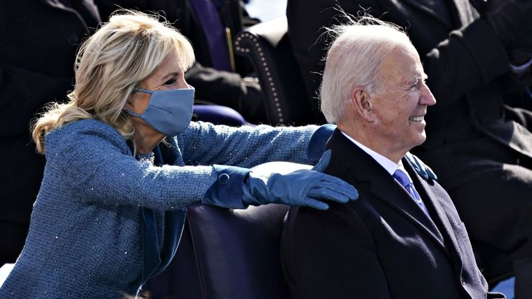 First Lady Jill Biden places her hands on U.S. President Joe Biden during the 59th Presidential Inauguration in Washington, U.S., January 20, 2021. Kevin Dietsch/Pool via REUTERS