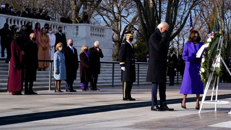 Joe Biden and Kamala Harris stand in front of former US presidents at a wreath laying ceremony