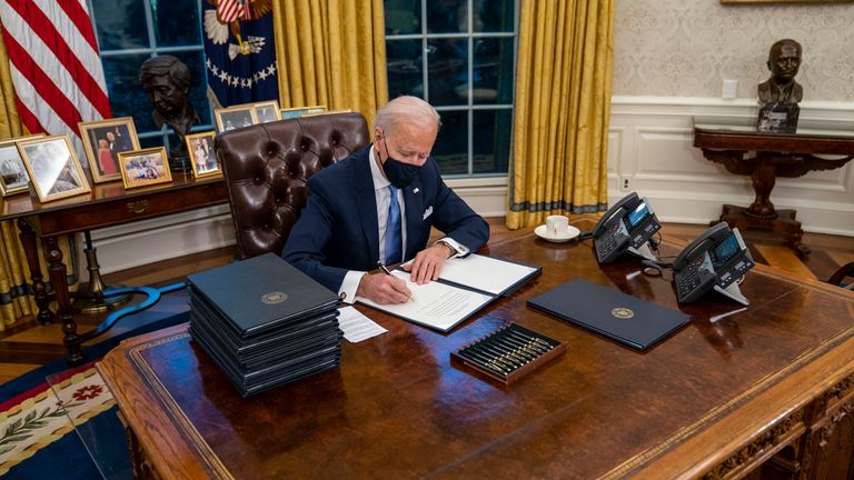 President Joe Biden in his newly furnished Oval Office. Pic: AP