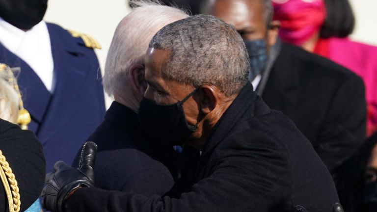 Former U.S. President Barack Obama embraces U.S. President Joe Biden during the inauguration of Biden as the 46th President of the United States on the West Front of the U.S. Capitol in Washington, U.S., January 20, 2021. REUTERS/Kevin Lamarque