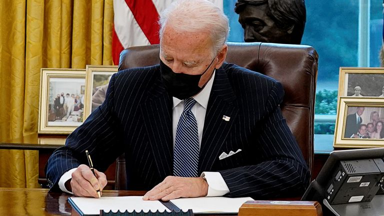 U.S. President Joe Biden signs an exectutive order repealing President Trump?s ban on transgender people serving in military, as he meets with new U.S. Defense Secretary Lloyd Austin in the Oval Office at the White House in Washington, U.S., January 25, 2021. REUTERS/Kevin Lamarque