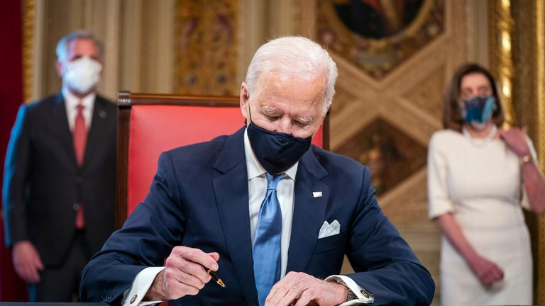 Joe Biden signs an inauguration declaration after being sworn in as president