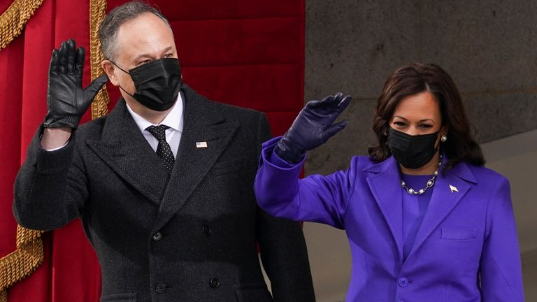 Vice President-elect Kamala Harris and her spouse Doug Emhoff arrive for the inauguration of Joe Biden as the 46th President of the United States on the West Front of the U.S. Capitol in Washington, U.S., January 20, 2021. REUTERS/Kevin Lamarque