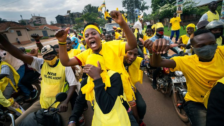 Supporters of Ugandan President  Yoweri Kaguta Museveni celebrate in Kampala, Uganda, Saturday Jan. 16, 2021, after their candidate was declared winner of the presidential elections. (AP Photo/Jerome Delay)