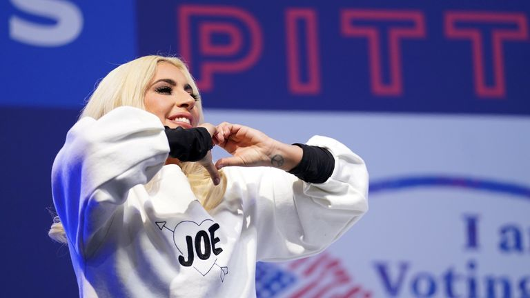 Lady Gaga makes a heart gesture as she performs during a drive-in campaign rally held by Democratic U.S. presidential nominee and former Vice President Joe Biden at Heinz Field in Pittsburgh, Pennsylvania, U.S., November 2, 2020. REUTERS/Kevin Lamarque/File Photo