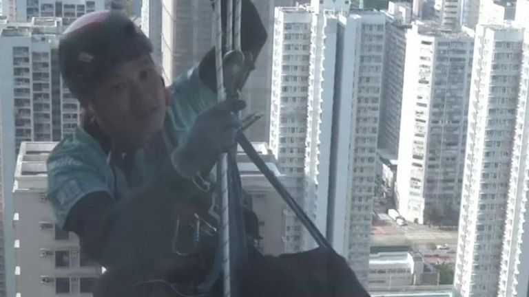 Lai Chi-wai became the first in Hong Kong to climb more than 250 meters of a skyscraper while strapped into a wheelchair