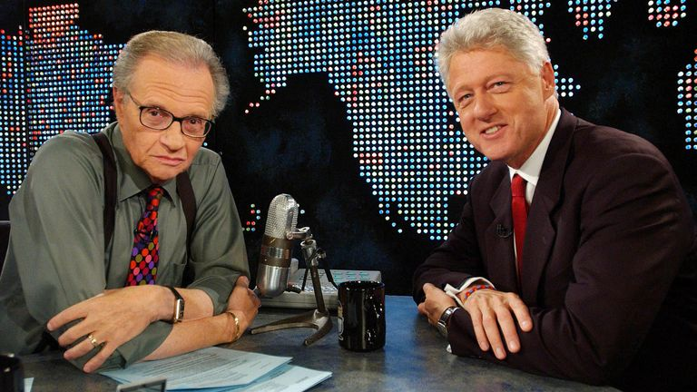 Former President Bill Clinton (R) speaks with Larry King on CNN in New York on September 3, 2002