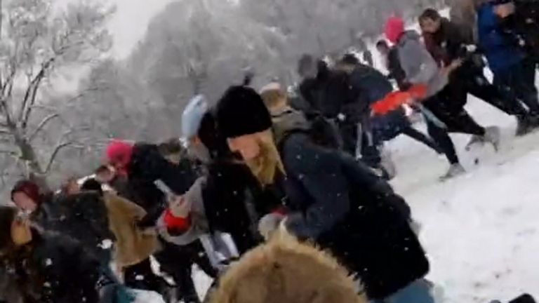 People taking part in a large snowball fight in Hyde Park, Leeds (Pic: @42adam42/TikTok)