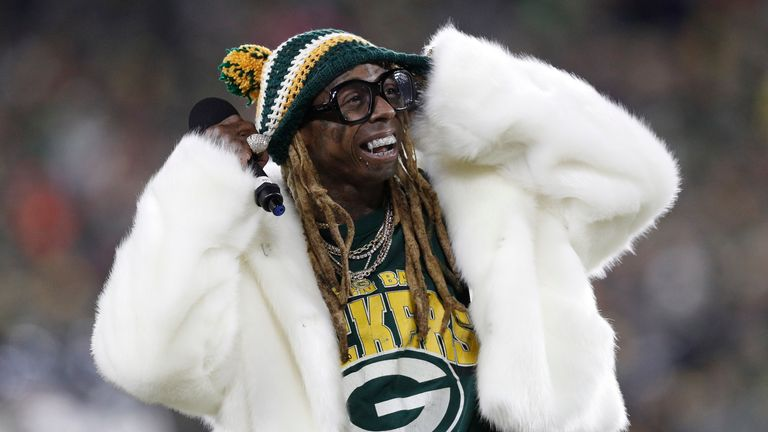 Lil Wayne addresses the crowd in the second half of a NFC Divisional Round playoff football game between the Green Bay Packers and Seattle Seahawks at Lambeau Field. Pic: Reuters/Jeff Hanisch-USA TODAY Sports