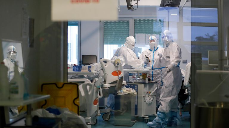 Medical personnel work inside a COVID-19 Intensive Care Unit at the Military Hospital in Lisbon