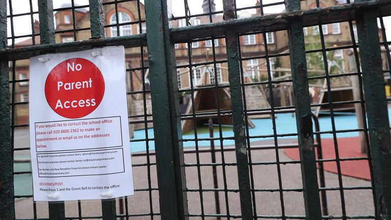 A sign saying 'no parent access' on a primary school gate in London