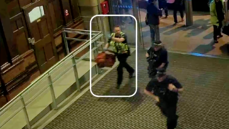Firearms officer running towards the scene of the attack