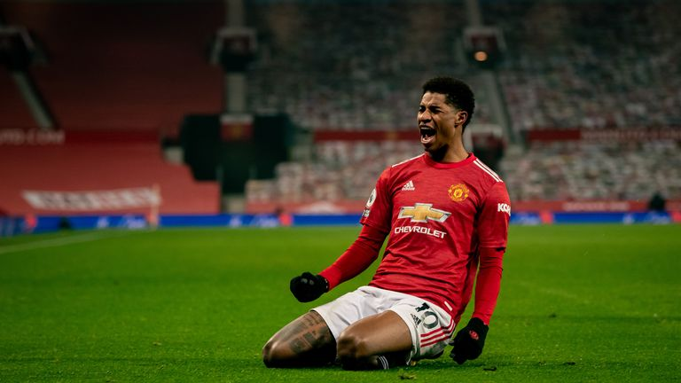 Marcus Rashford of Manchester United celebrates scoring a goal to make the score 1-0 during the Premier League match between Manchester United and Wolverhampton Wanderers at Old Trafford on December 29, 2020 in Manchester, United Kingdom. The match will be played without fans, behind cloed doors as a Covid-19 precaution. (Photo by Ash Donelon/Manchester United via Getty Images)