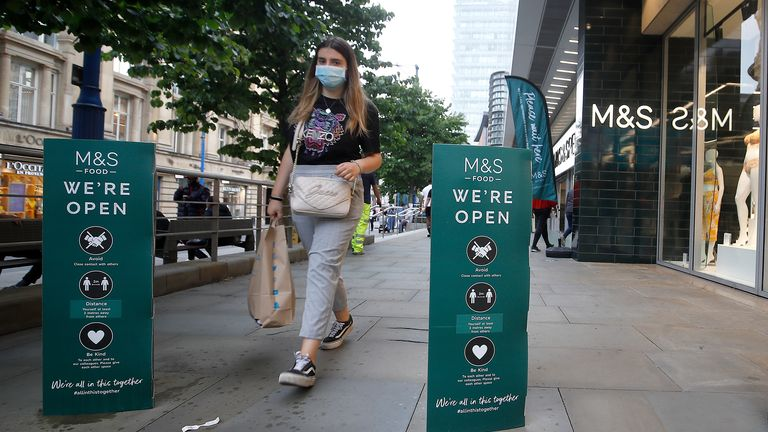 Shoppers outside Marks and Spencer in Manchester, as non-essential shops in England open their doors to customers for the first time since coronavirus lockdown restrictions were imposed in March