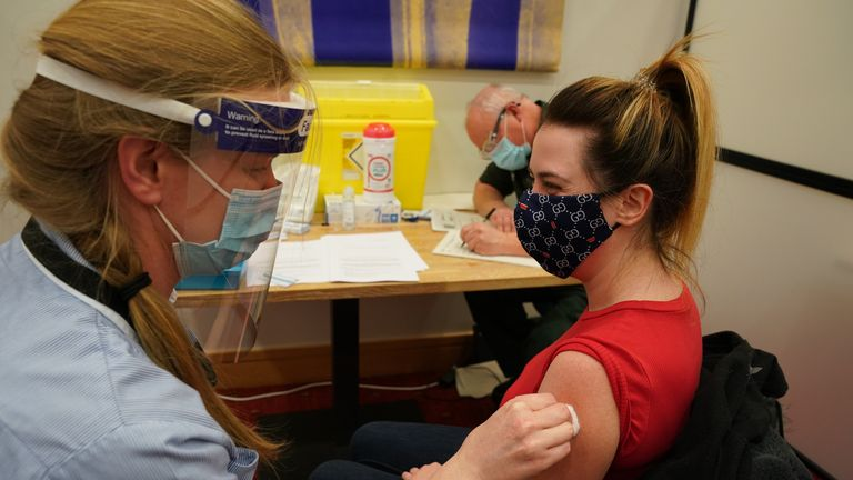A health and social care worker receives her vaccine at one of the seven mass vaccination centres in Newcastle
