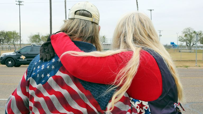 Supporters of U.S President Donald Trump wait for his arrival near Miller International airport on Tuesday, Jan. 12, 2021, in McAllen, Texas.