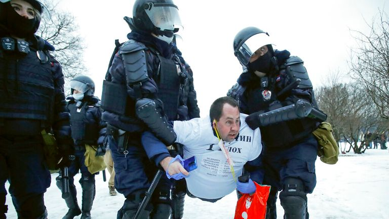A man is carried away by armoured police