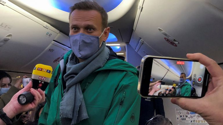 Russian opposition leader Alexei Navalny is seen on board a plane before the departure for the Russian capital Moscow at an airport in Berlin, Germany January 17, 2021
