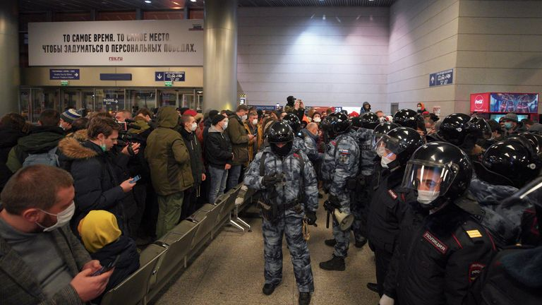 Law enforcement officers stand guard before the expected arrival of Russian opposition leader Alexei Navalny on a flight from the German capital Berlin at Vnukovo International Airport in Moscow, Russia January 17, 2021