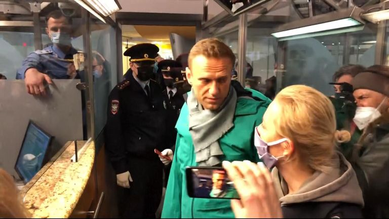 Moment Navalny detained after landing in Russia