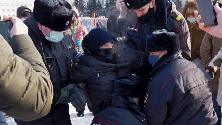 Police detain a man  in Khabarovsk, Russia, during a protest against the jailing of Alexei Navalny. Pic: AP