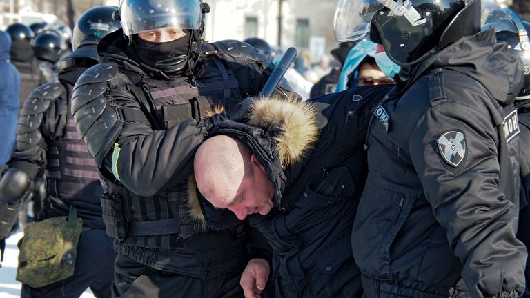 Police detain a man in in Khabarovsk, Russia, during a protest against the jailing of Alexei Navalny