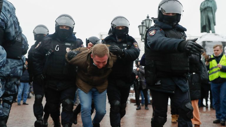 Police detain a man in Moscow. Pic: AP