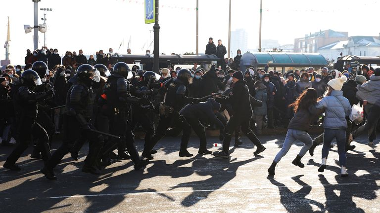 Protesters run away from police officers in Vladivostok,