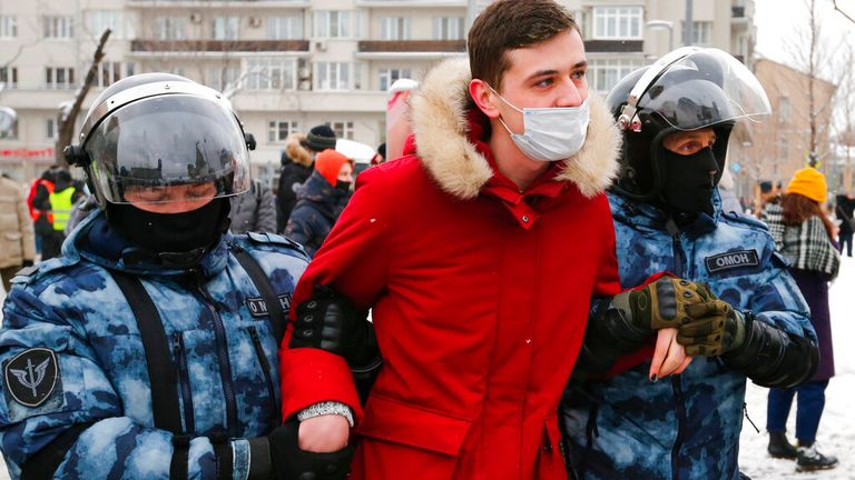 A man is arrested in Moscow as thousands took to the streets to demonstrate. Pic: Associated Press