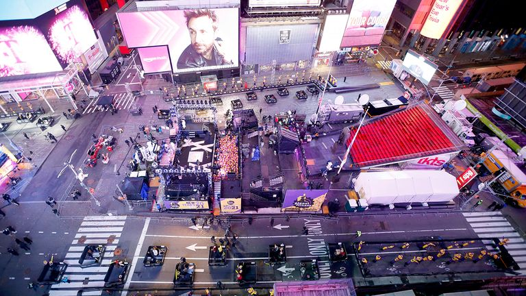 Revellers sit in their pods in Times Square on New Year's Eve