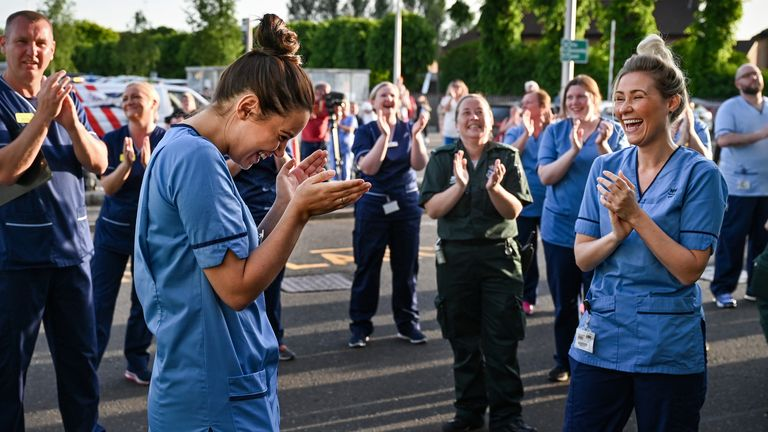 "GLASGOW - MAY 28: NHS staff at the Queen Elizabeth Hospital participate in what is expected to be the final Clap for Carers and key workers during week ten of lockdown on May 28, 2020 in Glasgow, United Kingdom. For 10 weeks, the public have applauded NHS staff and other key workers from their homes at 8pm every Thursday as part of ""Clap for Our Carers"". Annemarie Plas, the founder of the campaign, has now called for an end to the new tradition, suggesting that an annual clap should take its pla"