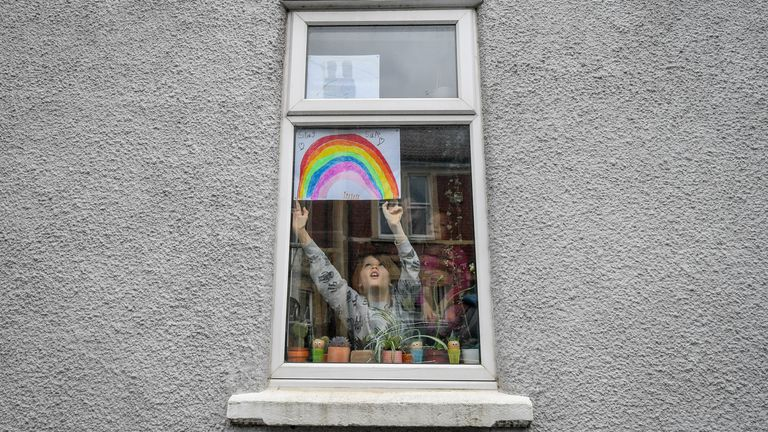 PA REVIEW OF THE YEAR 2020 File photo dated 01/04/20 of Jack Tucker, 7, placing his rainbow in the window of a house in Bedminster, Bristol as the UK continued in lockdown to help curb the spread of the coronavirus. .