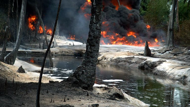 Oil from a leaking pipeline burns in Goi-Bodo, a swamp area of the Niger Delta in October 2004. Oil company Royal Dutch Shell said at the time the leak was caused by unknown saboteurs.