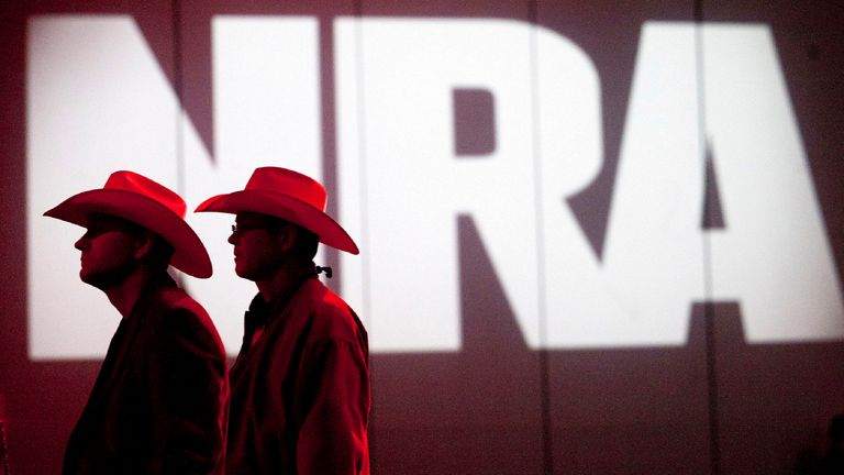 National Rifle Association members during one of the group's annual meetings in Houston, Texas - the state it plans to relocate to. Pic: AP