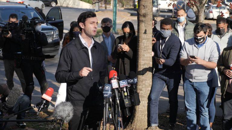 Democrat Jon Ossof speaks to reporters as voting took place