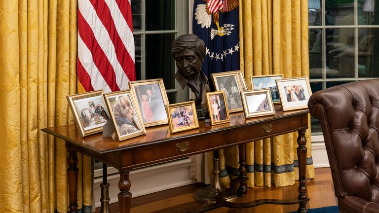 The president has a table filled with family photos. Pic: AP