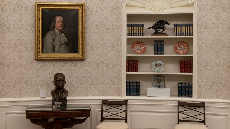 On the table is a bust of former President Harry Truman and to the right is a rock from the moon on a shelf. Pic: AP