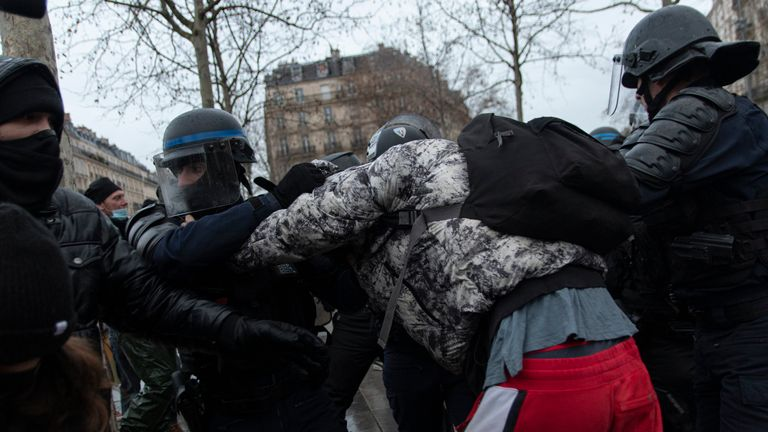 Police breaking up the protests in Paris ahead of a 6pm curfew. Pic: AP