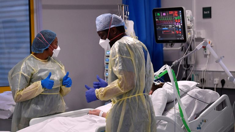 Nurses treat a patient in ICU at Milton Keynes University Hospital