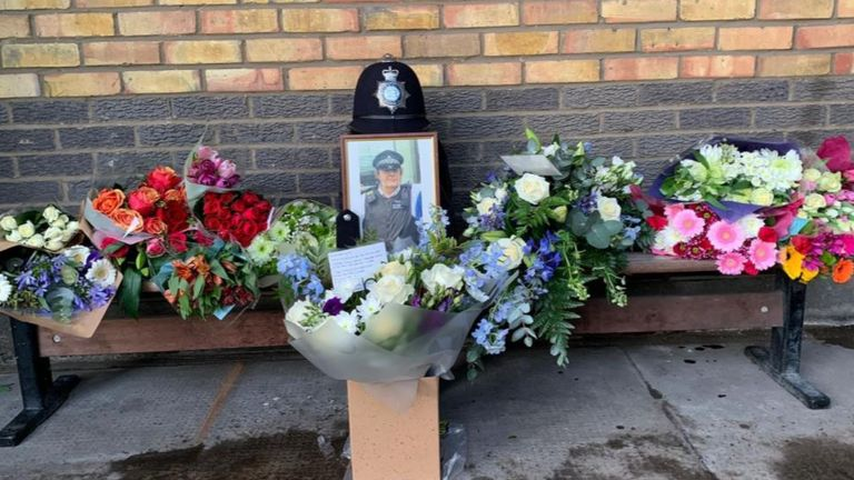 Tributes left to PC John Fabrizi. Pic: @MPSCamden/Twitter