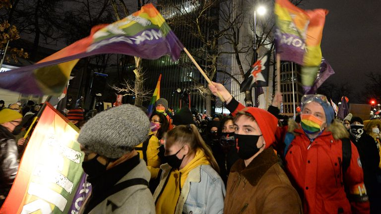 """Protesters marched with signs of the leading """"Women's Strike"""" group and pro-LGBT rights rainbow flags. Pic: AP"""