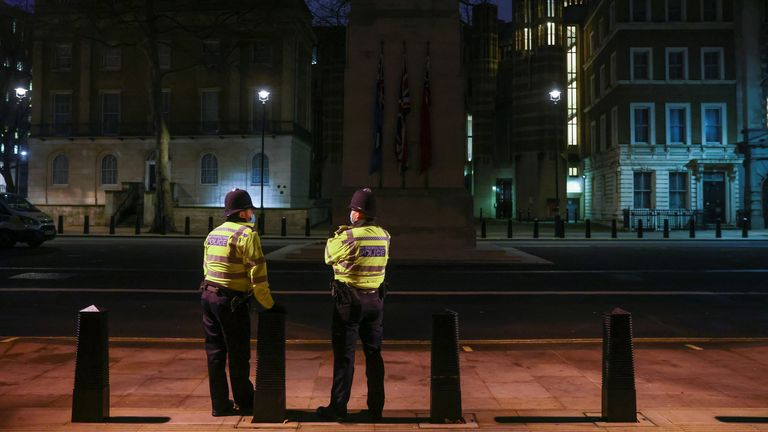 Police officers stand guard in London. File pic