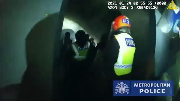 Officers break into a space being used for an illegal rave