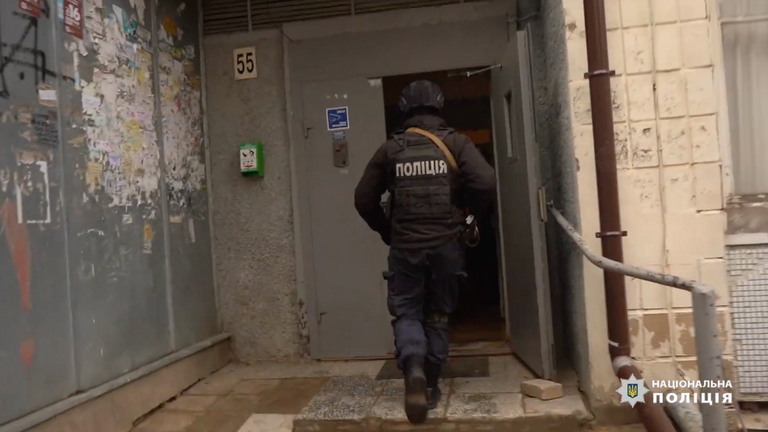 Armed police raided premises occupied by the cyber criminals. Pic: National Police of Ukraine