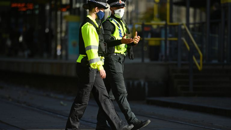 Police patrol the streets of Manchester with face masks on