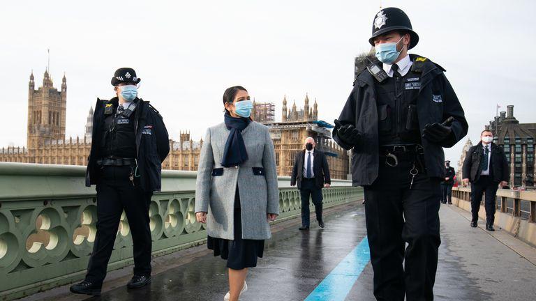 Home Secretary Priti Patel walks across Westminster Bridge whilst on patrol with Metropolitan Police officers in London