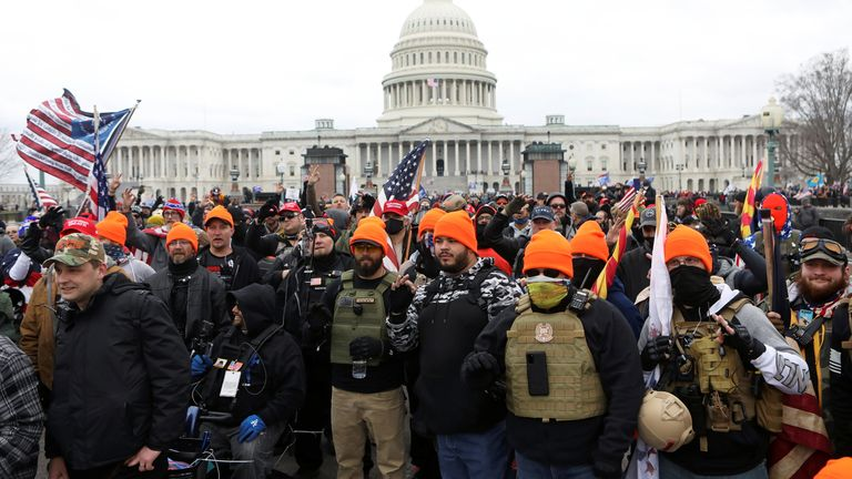Members of the Proud Boys (in orange hats) were seen in the Capitol