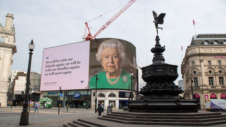 PA REVIEW OF THE YEAR 2020 - PA PHOTOGRAPHERS' FAVOURITE IMAGES File photo dated 08/04/20 of an image of Queen Elizabeth II and quotes from her broadcast to the UK and the Commonwealth in relation to the coronavirus epidemic displayed on lights in London's...