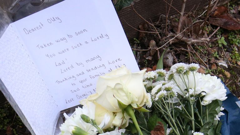 Floral tributes and a card left at the scene in Emmer Green