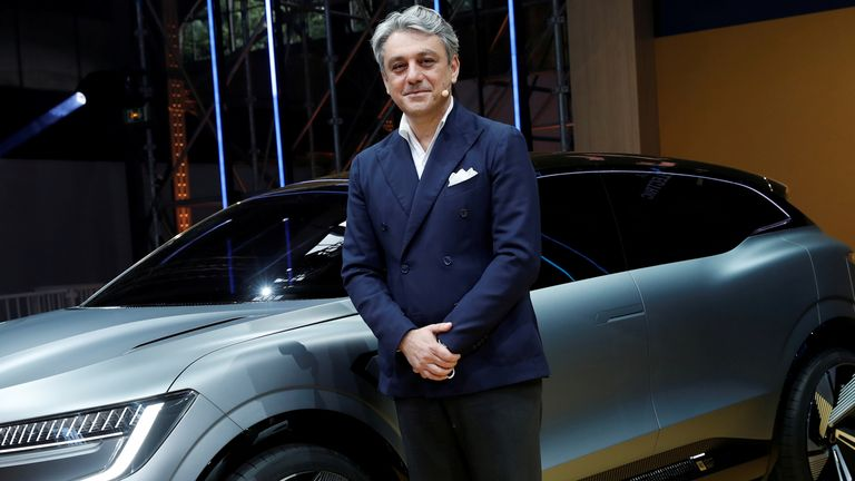 Luca de Meo, Chief Executive Officer of Groupe Renault, poses in front of a Renault Megane eVision car during a news conference about Renault electric strategy during Renault eWays event in Meudon, France, October 15, 2020